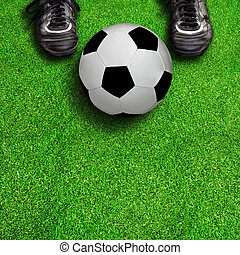 Soccer Boots and Ball on Field With Copy Space