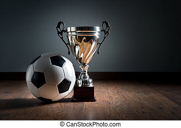 Soccer championship cup - Gold cup trophy and soccer ball on...