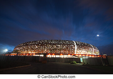 South africa will host the 2010 world cup of soccer. Jewel of the crown is the soccer city in soweto-johannesburg, and the stadium capable of 80000 people will host the first and final match of the competition. Here a nightshot of the stadium.