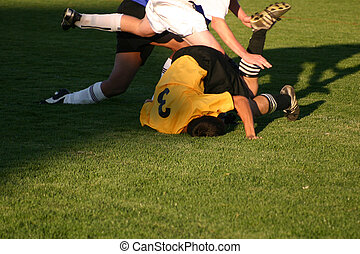 Soccer Collision - Soccer players collide while trying to...