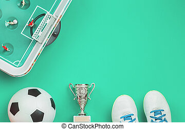 Soccer concept with football table game, cup and ball
