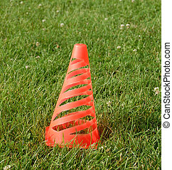 soccer cone standing on grass