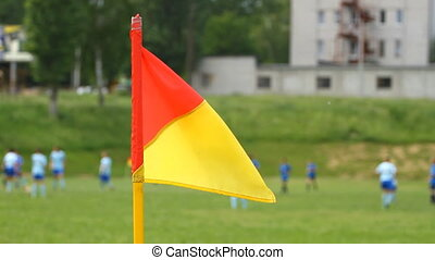 Soccer corner flag and children play football