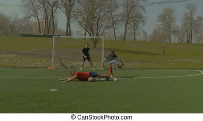 Soccer defense player making sliding tackle - Skillful...