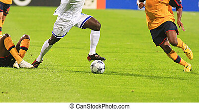 Soccer - Detail of a soccer game with many players in action...