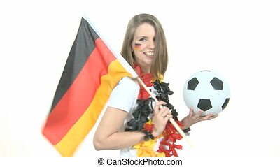 Attractive female Soccer Fan dances with german flag and kisses football