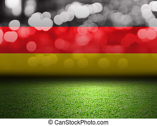 Soccer field and bokeh with germany flag