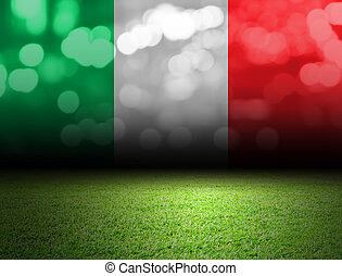 Soccer field and bokeh with italy flag