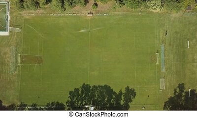 Soccer field from above - Football pitch being irrigated...