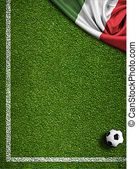Soccer field with ball and flag of Italy
