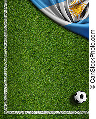 Soccer field with ball and flag of Argentina