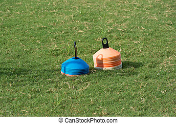 Soccer field with stack of flat marker cone, training materials
