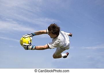 Soccer - Football Goal Keeper Making Diving Save