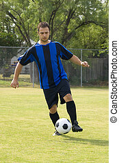 Soccer - Football Player dribbling