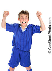Soccer Glory - An elated boy celebrates with two fists in...