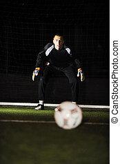soccer football goal keeper in night with falling rain