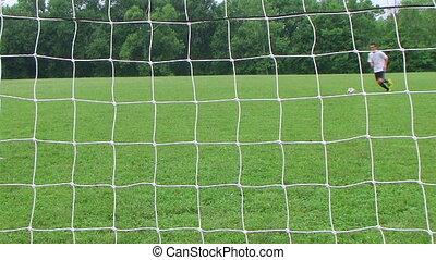 Soccer Goal Kick - Soccer player kicks goal.
