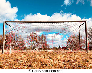 soccer goal on countryside, low angle view of rural soccer field
