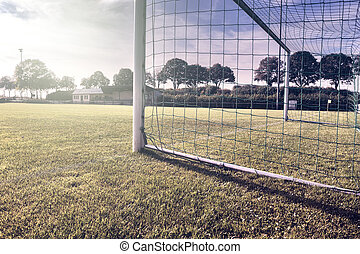 Soccer goal on summer field