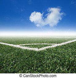 Soccer  grass field with blue sky