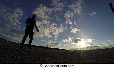 soccer. Man is hitting sport ball soccer football the sunset...