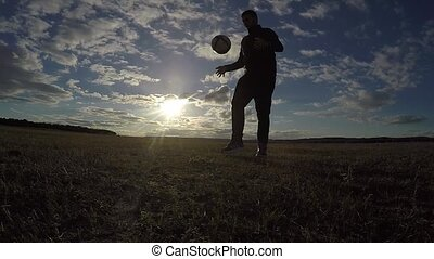 soccer. Man is stuffing a football lifestyle soccer ball...