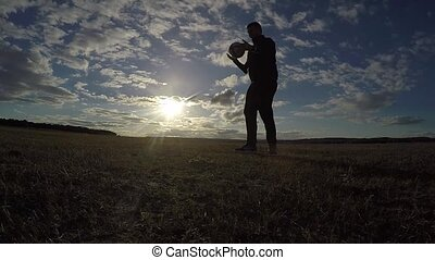 soccer. Man is stuffing a football soccer ball silhouette at...
