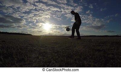 soccer. Man is stuffing a football soccer ball sport...