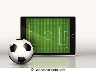 Soccer or football in front of an electronic device with pitch on screen