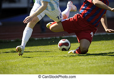 Soccer palyers - two male soccer players is fighting for the...