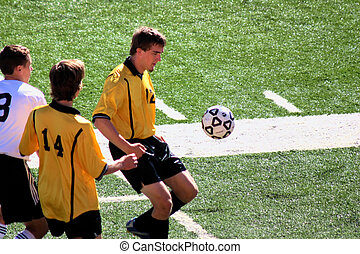 Soccer player about the bring the ball down.