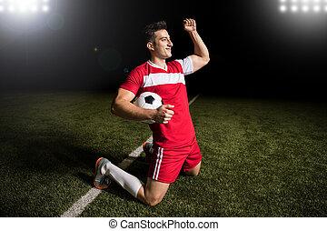 Soccer player celebrating after scoring