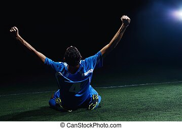 soccer player doing kick with ball on football stadium field...