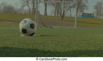 Soccer player executing penalty kick during training -...