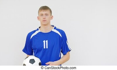 Soccer Player Flipping a Ball in White Background and...