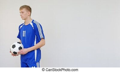 Soccer Player Getting a Yellow Card from Referee in White...