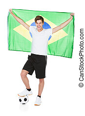 Soccer Player Holding Brazil Flag