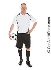 Soccer Player Holding Football