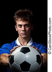 Soccer player is holding ball