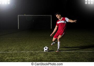 Soccer player kicking the football