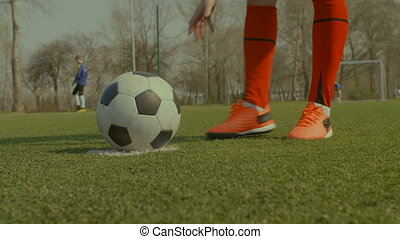Soccer player placing the ball on penalty spot - Closeup of...