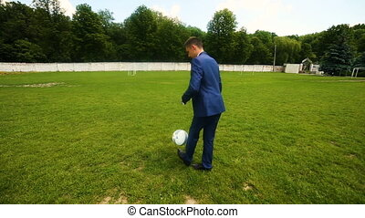 Soccer player playing with ball on field. Wide angle.