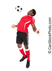 Soccer Player Playing With Football