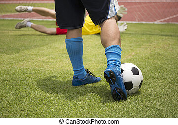 soccer player running before shooting
