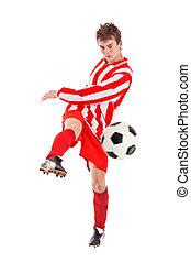Soccer player shooting a ball