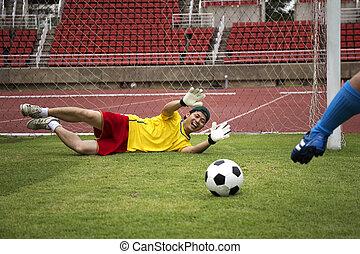 soccer player shooting the football