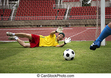 soccer player shooting the football