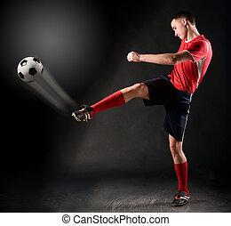 soccer player strikes