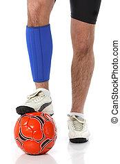 Soccer player wearing a neoprene brace, over white