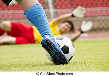 soccer player with ball before shooting